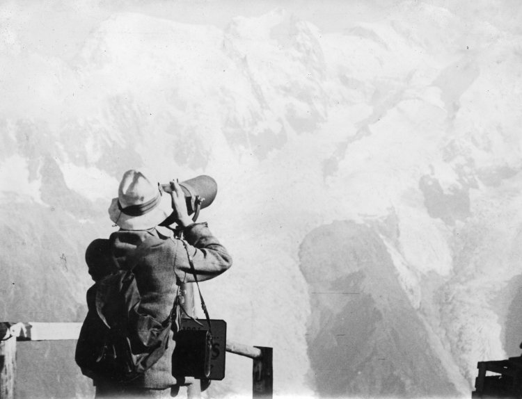 Ben H Humble looking through a telescope at the Matterhorn in Switzerland